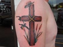 Cross in Reeds Tattoo
